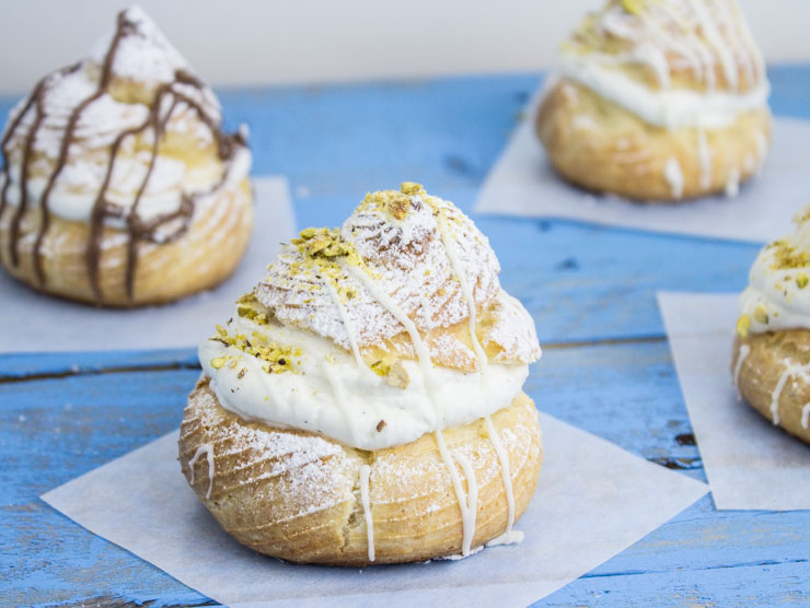 Cream Puffs topped with Chocolate and Pistachios
