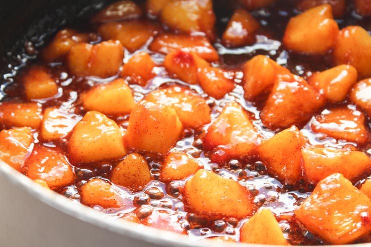 Simmering Peaches in Cinnamon Syrup