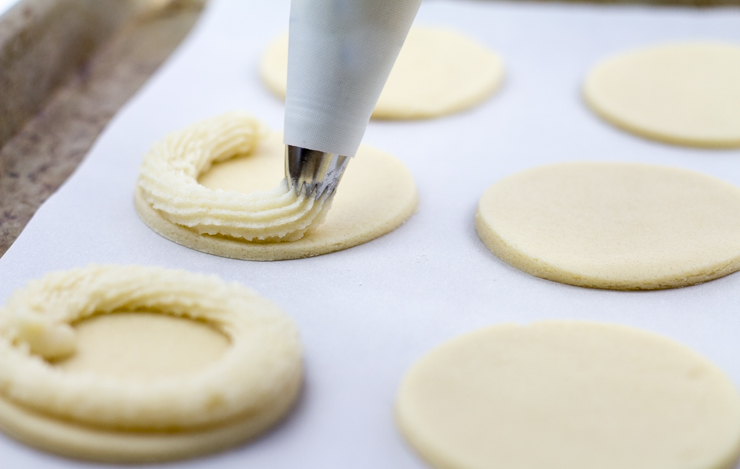 Piping Marzipan Around Shortbread Cookies